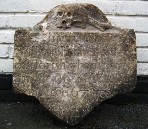 Broken tombstone of William Herbert, died 1705
